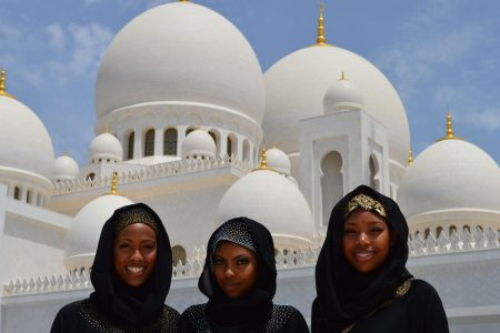 three-women-taking-a-photo-in-front-of-white-mosque-1361670-min